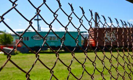 train fence stock image