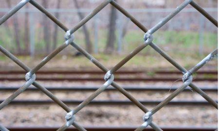 train tracks fence stock