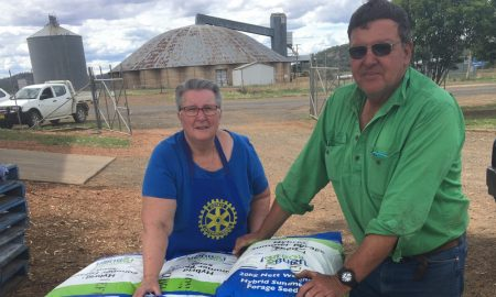 Robyn Skillen and Michael Nott -members of Boggabri Rotary club with the seed at the Boggabri Pursehouse depot