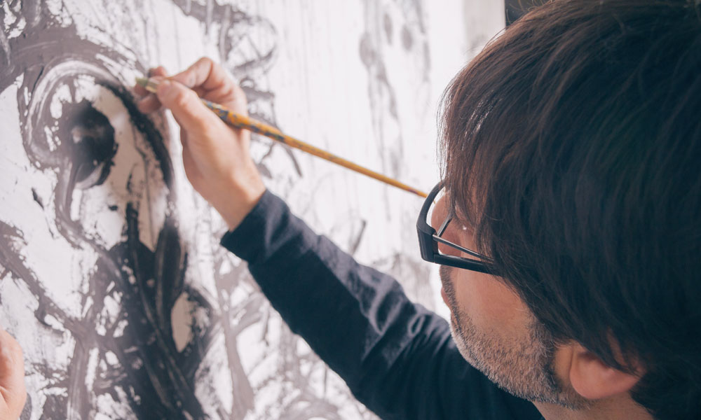 artist man draws stock image