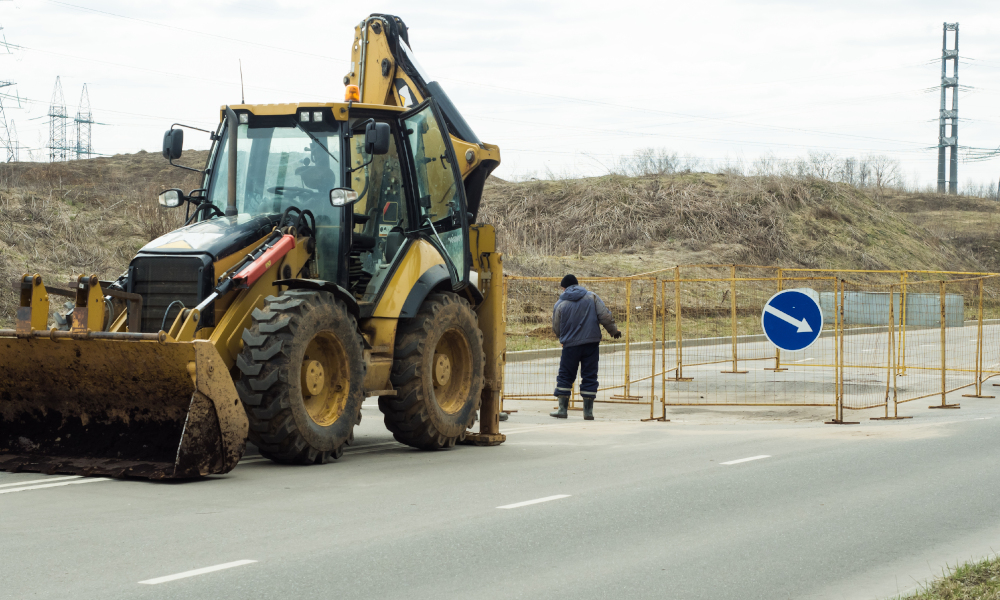 fencing installation on road stock image