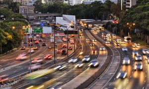 Sydney warringah freeway rush hour traffic with blurred head lights at sunset
