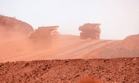 mining iron ore trucks stock image