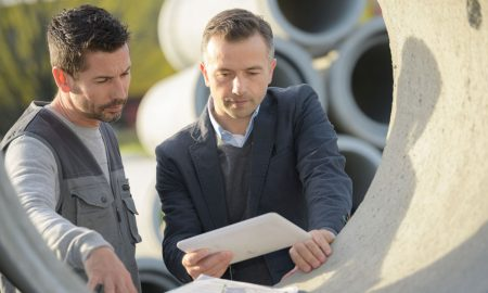 concrete pipes men stock image