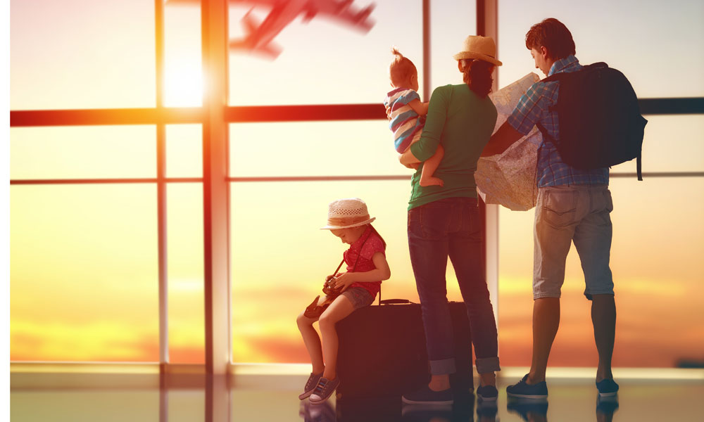 family with suitcases stock image